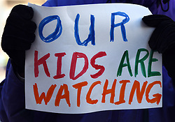 "December 10, 2016 - Washington, DC, USA - A man holds a sign saying ''Our Kids Are Watching''.  Children's Rally for Kindness takes place at Trump International Hotel in Washington DC on December 10, 2016 organized by the Takoma Parents Action Coalition.  According to their FaceBook page, it was a call to President-elect Donald Trump: ''to remember these lessons as he prepares to take office and implement policies that will affect the lives of children and families across our diverse nation.''.''All over the world, across cultures and countries, children learn the same basic lessons: .Ã'be kind,Ã"" .Ã'tell the truth,Ã"" .Ã'be fair,Ã"" .Ã'respect everyone,Ã"" .Ã'treat others the way you want to be treated,Ã"" .Ã'donÃ•t touch others if they donÃ•t want to be touched. (Credit Image: © Carol Guzy via ZUMA Wire)"