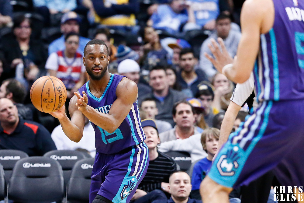04 March 2017: Charlotte Hornets guard Kemba Walker (15) passes the ball to Charlotte Hornets guard Nicolas Batum (5) during the Charlotte Hornets 112-102 victory over the Denver Nuggets, at the Pepsi Center, Denver, Colorado, USA.