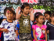 "13 JANUARY 2018 - BANGKOK, THAILAND:        Thai children dance during Children's Day activities at the Royal Thai Army's King's Guard 2nd Cavalry Camp in central Bangkok. Children's Day is called ""Wan Dek"" in Thai. Many government offices and military bases hold special activities for children as do shopping malls.  PHOTO BY JACK KURTZ"