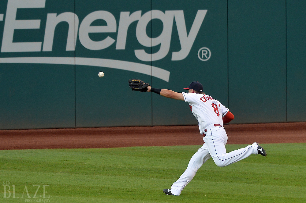 Aug 2, 2016; Cleveland, OH, USA; Cleveland Indians right fielder Lonnie Chisenhall (8) can't get to a ball hit by Minnesota Twins first baseman Joe Mauer (not pictured) during the third inning at Progressive Field. Mandatory Credit: Ken Blaze-USA TODAY Sports