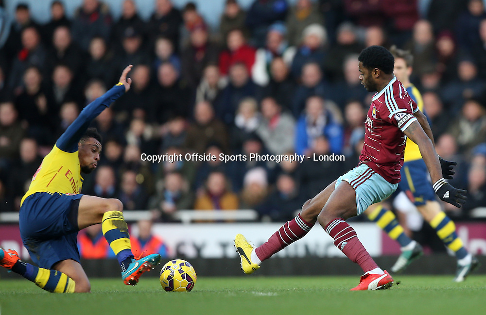 28 December 2014 Premier League Football - West Ham United v Arsenal; Francis Coquelin of Arsenal (right) and Alex Song of West Ham go for a 50-50 tackle.<br /> Photo: Mark Leech