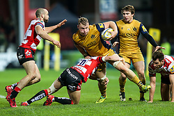 Mitch Eadie of Bristol Rugby is tackled by Charlie Sharples and Billy Burns of Gloucester Rugby - Rogan Thomson/JMP - 03/12/2016 - RUGBY UNION - Kingsholm Stadium - Gloucester, England - Gloucester Rugby v Bristol Rugby - Aviva Premiership.
