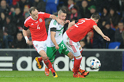 Conor Washington of Northern Ireland is challenged by David Vaughan of Wales and Chris Gunter of Wales - Mandatory by-line: Dougie Allward/JMP - Mobile: 07966 386802 - 24/03/2016 - FOOTBALL - Cardiff City Stadium - Cardiff, Wales - Wales v Northern Ireland - Vauxhall International Friendly