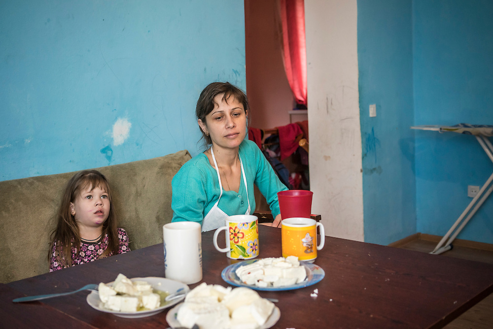 Olga Anisimova, 33 (center), who fled from Yalta on the Crimean peninsula, with her daughter Nastia, 3, on Tuesday, April 28, 2015 in Dubliany, Ukraine. The Russian takeover of Crimea forced Anisimova and her family to flee to the suburb of Lviv, where she has started a business selling home-made fresh cheese, though her hope is to move to Slovakia. CREDIT: Brendan Hoffman/Prime for the Wall Street Journal UKRMIGRATION