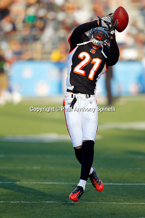 Cincinnati Bengals rookie cornerback Brandon Ghee (21) reaches for a pregame pass during the NFL Pro Football Hall of Fame preseason football game between the Dallas Cowboys and the Cincinnati Bengals on Sunday, August 8, 2010 in Canton, Ohio. The Cowboys won the game 16-7. (©Paul Anthony Spinelli)