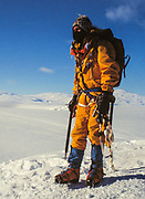 Colin Monteath wearing modern protective clothing and climbing harness, crampons etc, Ross Island, Antarctica