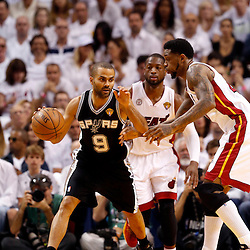 Jun 9, 2013; Miami, FL, USA;  San Antonio Spurs point guard Tony Parker (9) drives against Miami Heat power forward Udonis Haslem (40) during the first quarter of game two of the 2013 NBA Finals at the American Airlines Arena. Mandatory Credit: Derick E. Hingle-USA TODAY Sports
