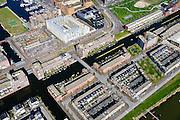 Nederland, Noord-Holland, Amsterdam, 20-04-2015; IJburg, bouwblokken op het Grote Rieteiland, de gracht Groene Tunnel en Haven-eiland Oost.<br /> IJburg, the new urban development district of Amsterdam, detail  of the street grid<br /> <br /> luchtfoto (toeslag op standard tarieven);<br /> aerial photo (additional fee required);<br /> copyright foto/photo Siebe Swart