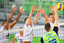 30-12-2019 SLO: Slovenia - Netherlands, Ljubljana<br /> Thijs Ter Horst, Nimir Abdel-Aziz of the Netherlands and Klemen Cebulj of Slovenia during friendly volleyball match between National Men teams of Slovenia and Netherlands