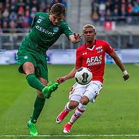 ALKMAAR - 01-04-2017, AZ - FC Groningen, AFAS Stadion, 0-0, FC Groningen speler Etienne Reijnen, AZ speler Dabney dos Santos Souza