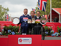 Prince Harry makes the presentations for the elite Wheelchair race winners to David Weir GBR and Manuela Schar SUI. The Virgin Money London Marathon, 23rd April 2017.<br /> <br /> Photo: Ben Queenborough for Virgin Money London Marathon<br /> <br /> For further information: media@londonmarathonevents.co.uk