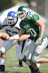 15 September 2007:  Kraig Ladd holds out the ball in front of a defender looking for a hand off. The Titans stood toe to toe with the 25th ranked Lions through the first half but ended the game on the losing end of a 25-15 score at Wilder Field on the campus of Illinois Wesleyan University in Bloomington Illinois.