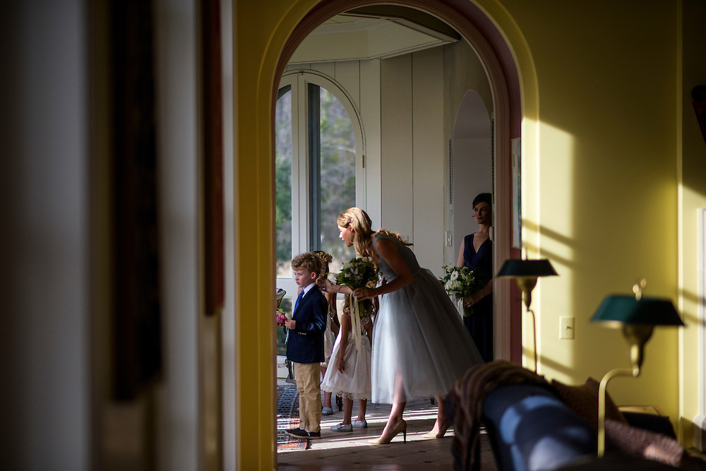 Annapolis, Maryland - April 18, 2015: Bridesmaid Hannah North helps ready the flower girls, one of which is her daughter. Fellow bridesmaid Mary Grace Fisher also waits in line. <br /> <br /> Stephanie Shearer Cate and Winston Bao Lord wed at their friends Jeff and Marry Zients' house in Annapolis, Maryland Saturday April 18, 2015. <br /> <br /> <br /> <br /> CREDIT: Matt Roth for The New York Times<br /> Assignment ID: 30173318A