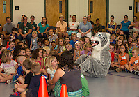 "Woodland Heights Elementary School mascot ""Whiskers"" sits among students during Thursday's assembly on PBIS (Positive Behavioral Intervention Supports).  (Karen Bobotas/for the Laconia Daily Sun)"