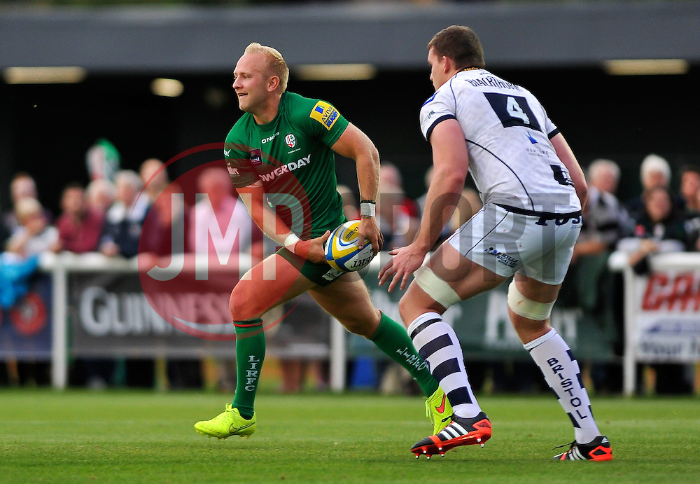 Shane Geraghty (London Irish) looks to pass the ball - Photo mandatory by-line: Patrick Khachfe/JMP - Mobile: 07966 386802 22/08/2014 - SPORT - RUGBY UNION - Middlesex - Hazelwood - London Irish v Bristol Rugby - Pre-Season Friendly