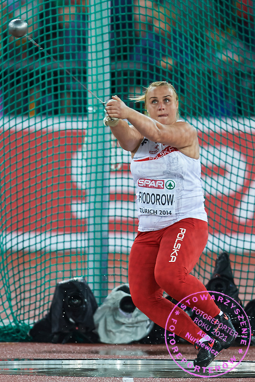 Joanna Fiodorow from Poland competes in women's hammer throw final during the Fourth Day of the European Athletics Championships Zurich 2014 at Letzigrund Stadium in Zurich, Switzerland.<br /> <br /> Switzerland, Zurich, August 15, 2014<br /> <br /> Picture also available in RAW (NEF) or TIFF format on special request.<br /> <br /> For editorial use only. Any commercial or promotional use requires permission.<br /> <br /> Photo by &copy; Adam Nurkiewicz / Mediasport