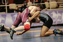 London, Ontario ---2013-03-02---  Chris Garneau of  Mcmaster takes on  Malcolm Meekins of  The University Of Sask in the men's 65 KG 5th/6th match at the 2012 CIS Wrestling Championships in London, Ontario, March 02, 2013. .GEOFF ROBINS/Mundo Sport Images