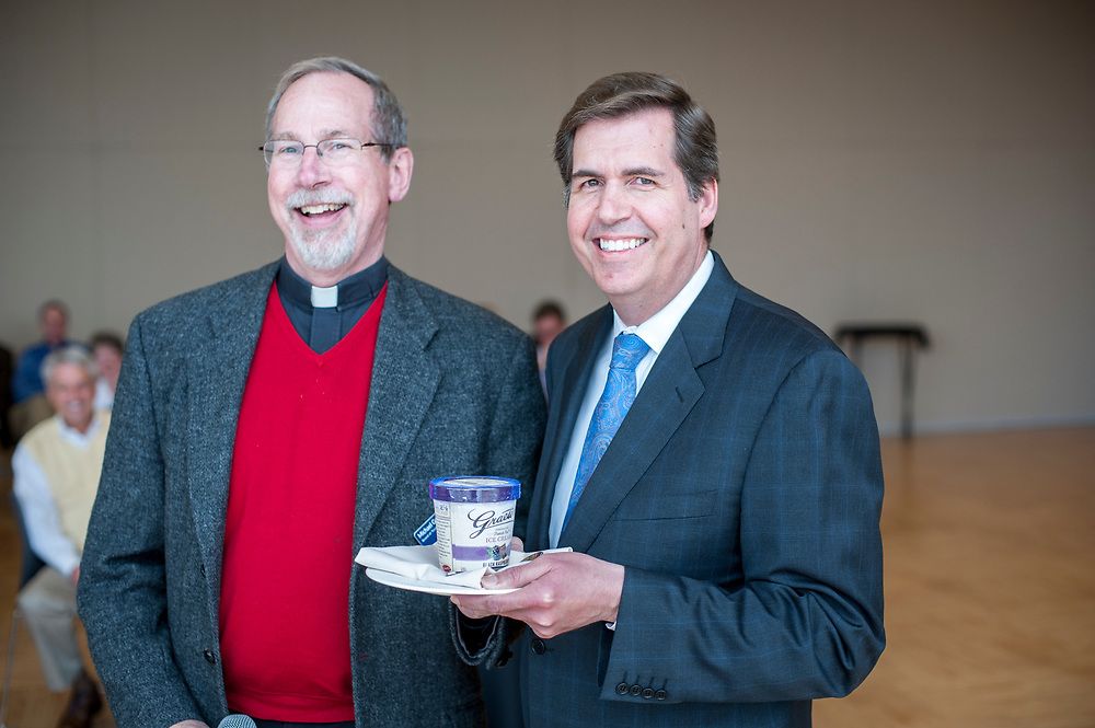 Xavier President Rev. Michael Graham, S.J., gives ice cream to GU President Thayne McCulloh after GU beat Xavier in the NCAA Tournament.