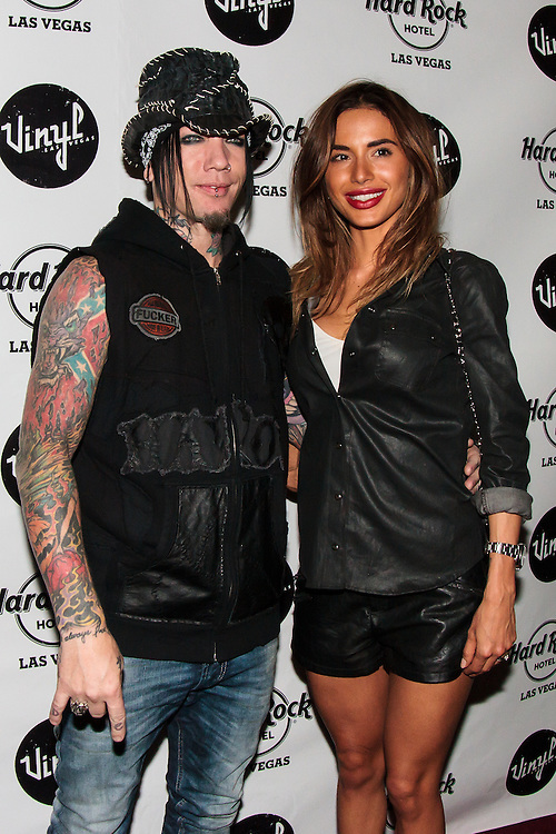 DJ Ashba of Guns 'n Roses with his wife, Nathalia Henao on the Black Carpet<br />