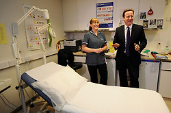 Leader of the Conservative Party David cameron meets Vanessa Owen a practice nurse at the Rowcroft Medical Centre, Stroud, Monday January 4, 2010. Photo By Andrew Parsons / i-Images.
