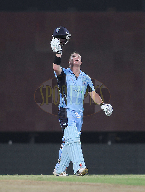 David Warner of NSW Blues raises his helmet a looks to the heavens after reaching his hundred during match 18 of the NOKIA Champions League T20 ( CLT20 )between the Chennai Superkings  and The NSW Blues held at the M. A. Chidambaram Stadium in Chennai , Tamil Nadu, India on the 4th October 2011..Photo by Shaun Roy/BCCI/SPORTZPICS