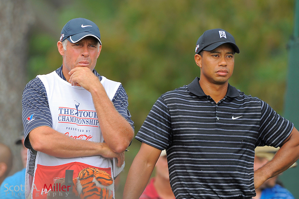 Tiger Woods (USA) and his caddie Steve Williams just before teeing off on the second hole during the third round of the PGA Tour Championship the final event of the 2009 FedEx Cup at East Lake Golf Club on Sept. 26, 2009 in Decatur, Ga.     ..©2009 Scott A. Miller