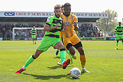 Forest Green Rovers Christian Doidge(9) and Cambridge United's David Amoo(7) during the EFL Sky Bet League 2 match between Forest Green Rovers and Cambridge United at the New Lawn, Forest Green, United Kingdom on 22 April 2019.