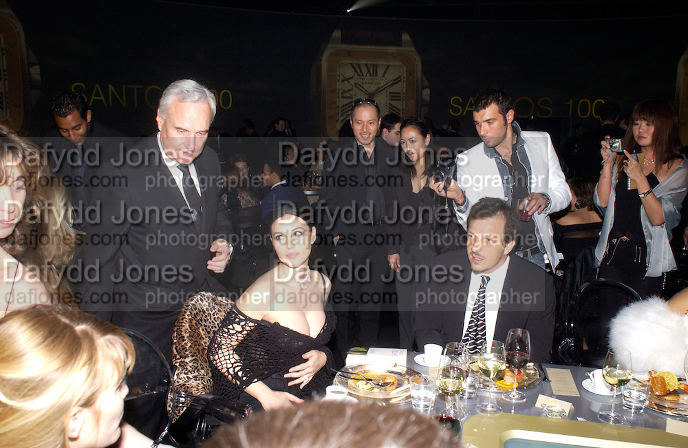 the president of Cartier Bernard Fornas, Monica Bellucci Gabriele Muccino, Party to celebrate 100 years of the Santos  de Cartier watch. Le Bourget airport. Paris. 7 April 2004. ONE TIME USE ONLY - DO NOT ARCHIVE  © Copyright Photograph by Dafydd Jones 66 Stockwell Park Rd. London SW9 0DA Tel 020 7733 0108 www.dafjones.com