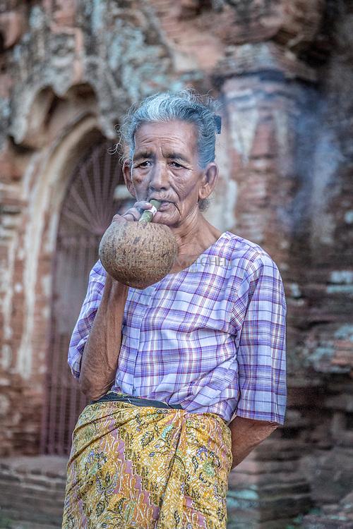 Local Bagan woman smoking a traditional cigar, Cheroot.