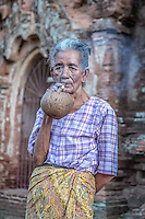 Local Bagan woman smoking a traditional cigar, Cheroot.