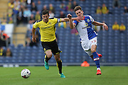 Sam Gallagher of Blackburn Rovers runs at John Mousinho of Burton Albion during the EFL Sky Bet Championship match between Blackburn Rovers and Burton Albion at Ewood Park, Blackburn, England on 20 August 2016. Photo by Simon Brady.