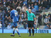 Brighton's Rohan Ince is shown the yellow card by Referee Andy Davies during the Sky Bet Championship match between Brighton and Hove Albion and Norwich City at the American Express Community Stadium, Brighton and Hove, England on 3 April 2015. Photo by Phil Duncan.