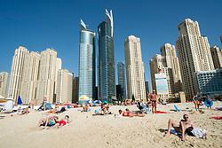 Beach and high-rise modern apartment buildings near Marina at New Dubai in United Arab Emirates