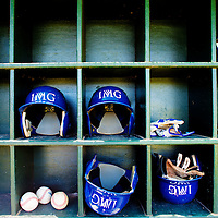 BRADENTON, FL -- May 21, 2012 --  Helmets sit in the dugout during an inter-squad game at IMG Baseball Academy where he trains and goes to school in Bradenton, Fla., on Monday, May 21, 2012.  (PHOTO/CHIP LITHERLAND)