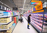 Lidl GB opens a new supermarket at The Tandem Centre in Colliers Wood, London, Great Britain on 4th June 2020.<br /> <br /> In response to the need to provide access to food supplies and essentials at this time, Lidl is delivering on its commitment to serve local communities, despite unprecedented circumstances.<br /> <br /> The store has created approximately 40 new jobs<br /> <br /> The new store will be providing surplus food to local charity Elevating Lives, who provide support to the homeless, and Wimbledon International Seventh Day Adventist Church for their monthly hot meals for seniors. This is delivered through Lidl's Feed it Back scheme in partnership with Neighbourly, working to help some of the vulnerable in society access high quality food.<br /> <br /> Lidl has introduced a range of social distancing measures to help maintain a safe store environment for both colleagues and customers. These include positioning designated team members at store entrances to manage the volume of people entering at one time, and clear communication, including floor markings, reminding customers of the importance of maintaining a two-metre distance from each other when shopping. It has also rolling out dedicated cleaning stations at store entrances for customers, including hand sanitiser, disinfectant and wipes, for them to use on their trolleys and baskets. <br /> <br /> <br /> Additionally, the supermarket has installed protective screens at checkouts along with the introduction of protective visors and masks for colleagues to wear if they wish, and is continuing to encourage customers to pay by contactless payment methods where possible. <br /> <br /> The new supermarket forms part of the company's £1.45bn investment in its expansion across Great Britain in 2019 and 2020, and a £500m dedicated investment in Greater London by 2025. With a total sales area of 942m², the new store also includes 428 shared parking spaces, and features facilities such as an in-store bakery an