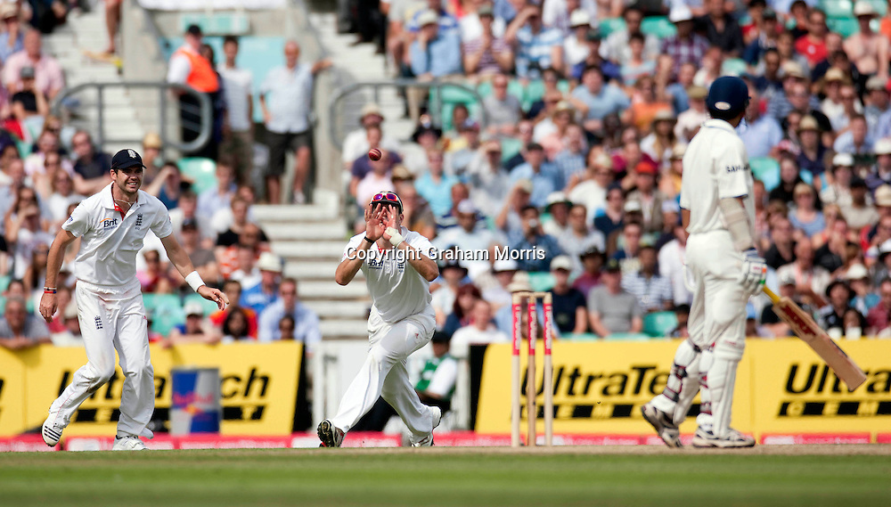 James Anderson watches as Kevin Pietersen catches Gautam Gambhir off Stuart Broad during the fourth and final npower Test Match between England and India at the Oval, London.  Photo: Graham Morris (Tel: +44(0)20 8969 4192 Email: sales@cricketpix.com) 21/08/11