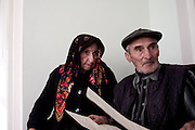 A member of the council of Kist elders shows papers containing the laws and traditions of the Kist people. The elders are still called upon regularly to help address issues between the different clans of the Pankisi Valley instead of using the local Georgian police.