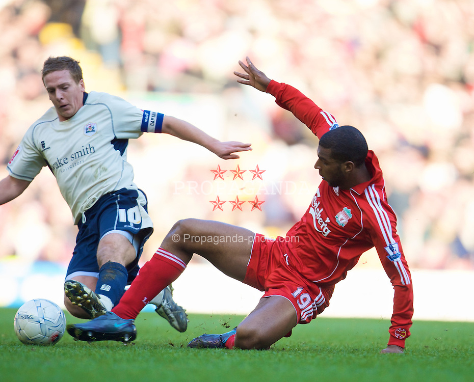 LIVERPOOL, ENGLAND - Saturday, February 16, 2008: Liverpool's Ryan Babel and Barnsley's captain Brian Howard during the FA Cup 5th Round match at Anfield. (Photo by David Rawcliffe/Propaganda)