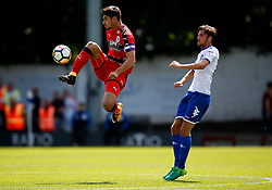 Christopher Schindler of Huddersfield Town jumps to control the ball  - Mandatory by-line: Matt McNulty/JMP - 16/07/2017 - FOOTBALL - Gigg Lane - Bury, England - Bury v Huddersfield Town - Pre-season friendly