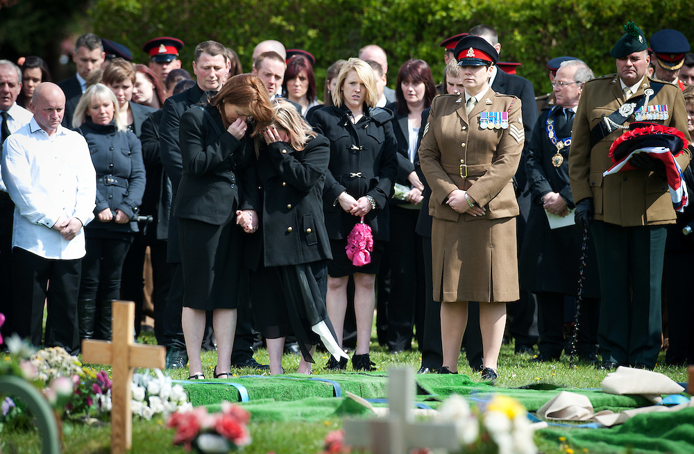 Widow Sophie Foley (Right) and Debbie mother of Michael (Left) cries at the grave of her deceased husband  Lance Corporal Michael Foley in Didcot Cemetery in Oxfordshire on April 19th 2012..The Funeral of Lance Corporal Michael Foley. Lance Corporal Michael Foley, of the Adjutant General's Corps (Staff and Personnel Support) was one of two servicemen shot dead by an Afghan soldier on March 26.2012.Photo Ki Price.