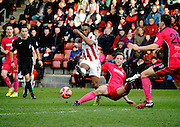 Craig Braham-Barrett shoots during the The FA Cup match between Cheltenham Town and Dover Athletic at Whaddon Road, Cheltenham, England on 7 December 2014.