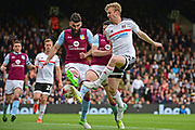 Fulham defender Tim Ream (13) clears from Aston Villa midfielder Mile Jedinak (25) during the EFL Sky Bet Championship match between Fulham and Aston Villa at Craven Cottage, London, England on 17 April 2017. Photo by Jon Bromley.