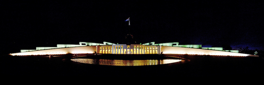 Australian Parliament House at night.