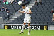 Milton Keynes Dons defender George Williams (2) heads the ball during the EFL Sky Bet League 1 match between Milton Keynes Dons and Coventry City at stadium:mk, Milton Keynes, England on 19 October 2019.