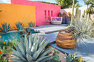 Pink and orange walls, aquamarine water feature pool, slab paving, patio furniture, wooden containers and drought proof plants including Agave and Kalanchoe beharensis<br /> <br /> Mediterranean drought proof garden inspired by the work of Mexican Modernist architect Luis Barragan.<br /> <br /> Inland Homes: Beneath a Mexican Sky<br /> <br /> Designed by<br /> Manoj Malde<br /> <br /> Built by<br /> Living Landscapes<br /> <br /> Sponsored by<br /> Inland Homes Pl