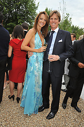 MOGENS THOLSTRUP and his wife GRETA at the annual Serpentine Gallery Summer Party sponsored by Canvas TV  the new global arts TV network, held at the Serpentine Gallery, Kensington Gardens, London on 9th July 2009.