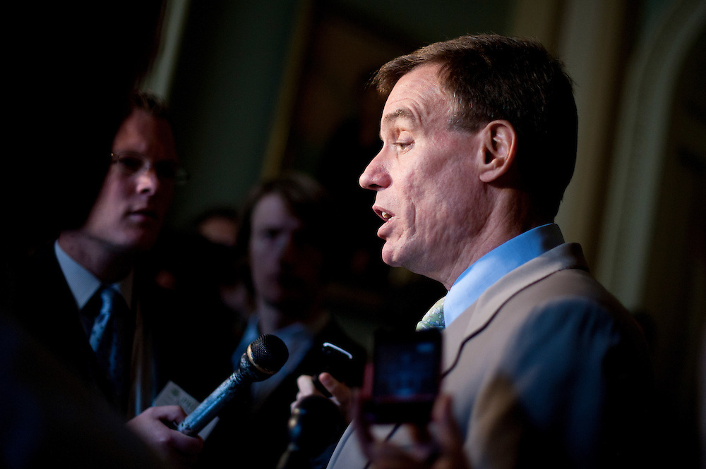 Senator MARK WARNER (D-VA) speaks to the media after voting on the compromise bill to raise the nation's debt ceiling. The Senate voted 74 to 26 to pass the measure that raises the debt ceiling and reduces the deficit by $2.4 trillion.  The bill will be sent to the White House where President Obama is expected to sign it.