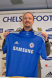 © licensed to London News Pictures. London, UK 22/11/2012. Rafael Benitez posing with a Chelsea shirt as a press conference taking place to unveil Chelsea FC's new interim first-team manager Rafael Benitez at Tambling Suite of Chelsea Football Club in London. Photo credit: Tolga Akmen/LNP