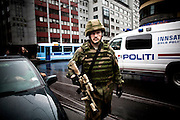 Oslo, Norway, 23.07.2011. Army rangers and the Royal Guard is deployed in the centyer city to get control of the city. Oslo awakes to shocking messages of the total bodycount after yesterdays massacre. A total of 91 persons were killed in the massacre in Utøya right outside Oslo. Seven of those died when a car bomb was detonated outside the main government biuilding in the heart of Oslo, friday 22. of July. Foto: Christopher Olssøn.