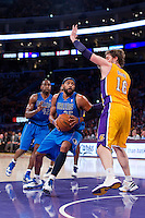 30 October 2012: Forward (25) Vince Carter of the Dallas Mavericks lays the ball up while being guarded by (16) Pau Gasol of the Los Angeles Lakers during the first half of the Mavericks 99-91 victory over the Lakers at the STAPLES Center in Los Angeles, CA.